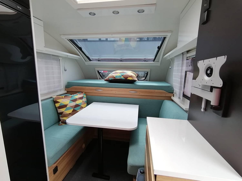 Der gemütliche Sitzbereich kann mit anthrazit oder türkisfarbenem Stoff gewählt werden.
